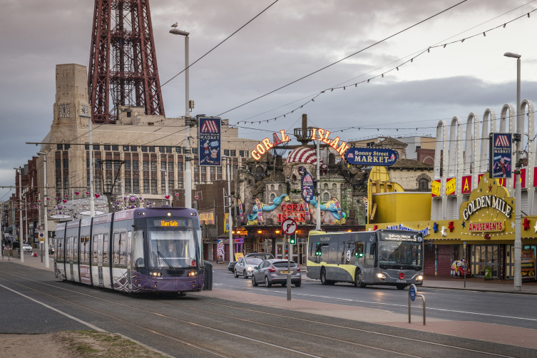 Bus and tram in front of Coral Island Blackpool